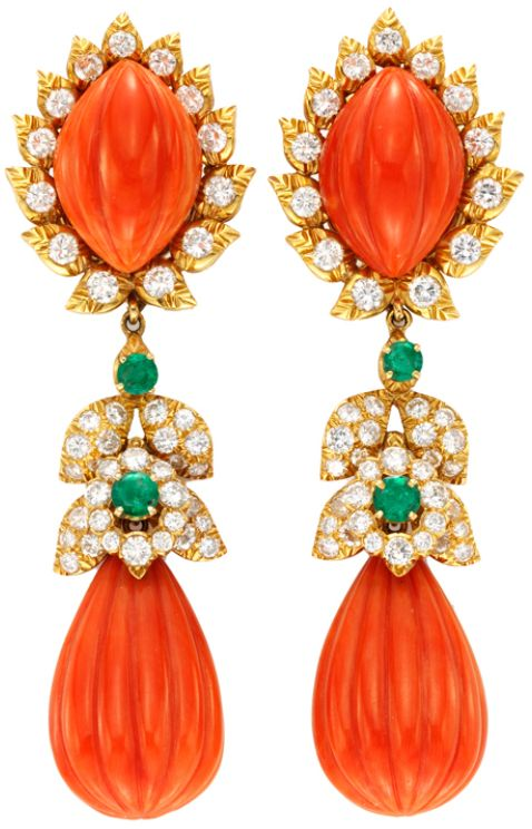 David Webb, A Pair of Carved Coral, Emerald and Diamond Ear Pendants, designed as a carved coral drop with a circular-cut emerald and diamond surmount, suspending from a detachable coral and diamond clip, mounted in 18k gold, signed Webb. Via 1stdibs.
