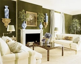 Love the olive green upholstered walls - would look beautiful in a dining room w/ dark wood and floral drapery. Living room