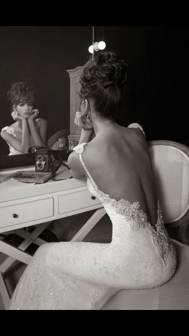 This IS THE most amazing wedding dress I have ever seen. Usually they are fruff ( Thea-ism) meaning fluffy, frilly, princess-like, uhhhhh !!  THIS IS; elegant, sexy but understated, classy, alluring.. And SHE wears it well. Have to have a tort figure & NO back fat ladies... A GREAT back with great body for this little number..  LOVE, LOVE, LOVE IT - I still believe in marriage.... :)