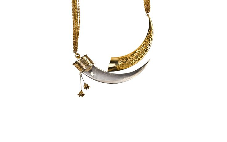 """Kirpan Necklace by Eina Ahluwalia All of Eina's pieces have strong symbolic meanings inspired by her home country and its culture, but the Kirpan necklace is particularly special. A kirpan is a traditional small sword carried by Sikh warriors, whose aim was to protect oppressed communities. Part of Eina's """"Wedding Vows"""" collection, the Kirpa"""