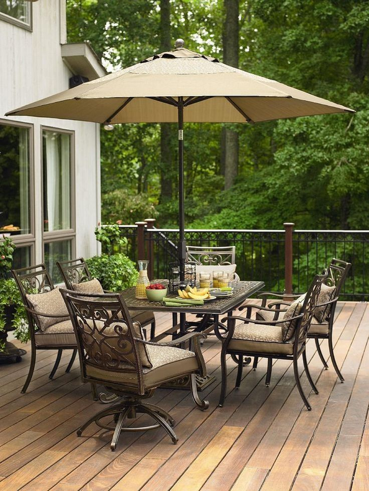 Outdoor Patio Sets With Awesome Umbrella Above Table And Unique Chairs Also  Using Wood Flooring