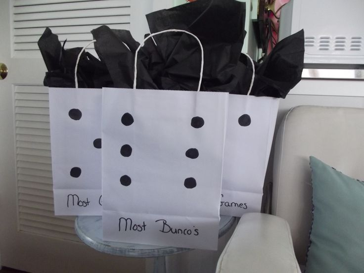 Easy DIY Cheap Bunco Gift Bags.  Bought plain white bags at Dollar Tree & used a sharpie to put the dice on them.  Bought black tissue paper for topping