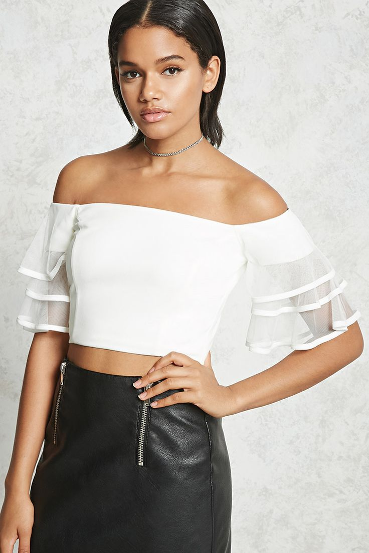 A textured stretch knit crop top featuring an off-the-shoulder neckline, short mesh-knit tiered bell sleeves, and an exposed back zipper.
