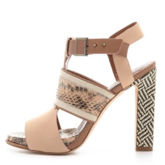 ONE DAY SALE Rachel Roy Faye sandal This mixed-media sandal of leather and snakeskin is a trendy neutral for any outfit. Heel is black and white raffia for a fun twist. Worn once. Optimal condition except for minor wear on the sole. Rachel Roy Shoes Sandals