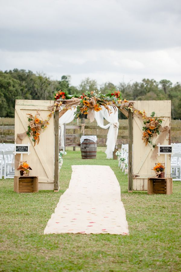 Real Weddings: Ashlei & Steven in Plant City, FL |Sunflowers, barn wedding, vintage barn doors, burlap runner, arbor