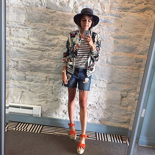"""Sometimes the most random combinations can make for the most on-point look. Orange wedges, loose denim shorts, a striped tee, and a floral bomber jacket, topped with a hat? This screams, """"I just threw something on,"""" in the best way possible. #refinery29 http://www.refinery29.com/august-outfit-of-the-day-ideas#slide-3"""