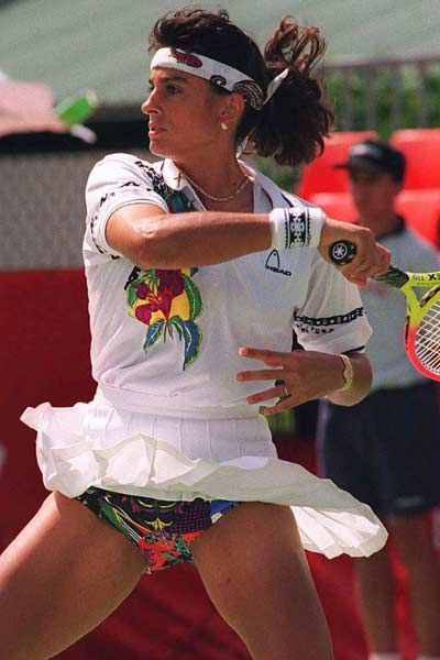 Sabatini in Action: Sabatini Upskirt Photo - Just a classic shot of the Argentine Sabatini from around 1995. Sabatini competed against top players like Steffi Graf, Monica Seles, Arantxa Sanchez-Vicario, and Conchita Martinez. Critics regarded Sabatini as being mentally frail, and her tendancy to choke in big matches plagued her career. But despite this, Sabatini's loopy topspin shots made life difficult for Arantxa and Conchita, while Sabatini's game frustrated Steffi and Monica as well!