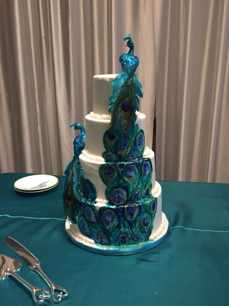 Painted peacock buttercream wedding cake by Well Dressed Cakes by Brett. www.welldressedcakes.ca