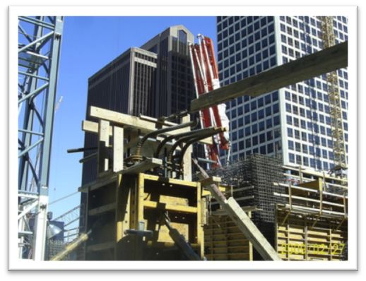 Pictures of concrete construction formwork for SCC pours, tower crane base installs, footing and wall forms as well as bridge forming.