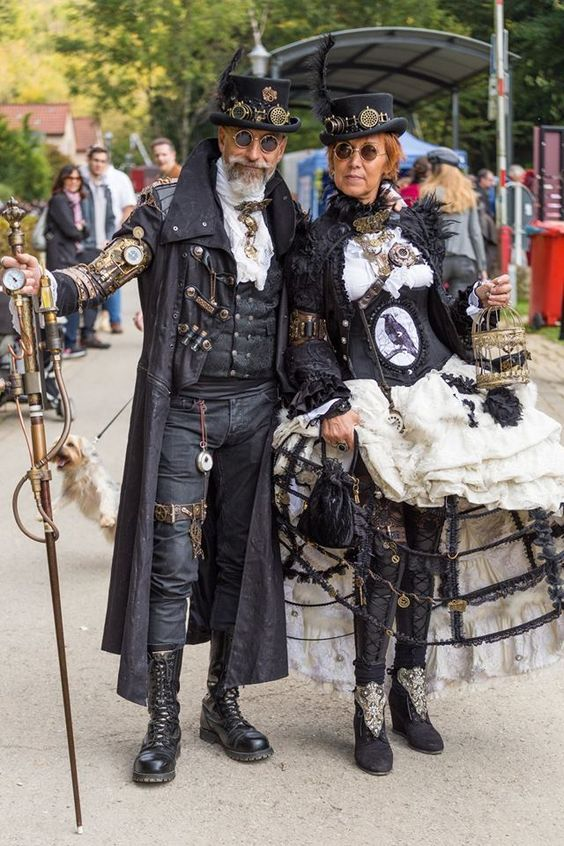 Stylish Steamgoth Couple in Complementary Costumes (gothic victorian steampunk matching/coordinating costumes for couples - For costume tutorials, clothing guide, fashion inspiration photo gallery, calendar of Steampunk events, & more, visit SteampunkFashionGuide.com