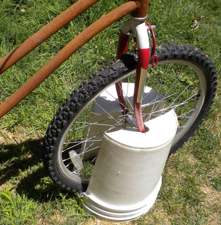Tired of your kids bikes lying around in the yard? Make a bike stand. Video instructions. #bucket #bikestand #soapwarehouse