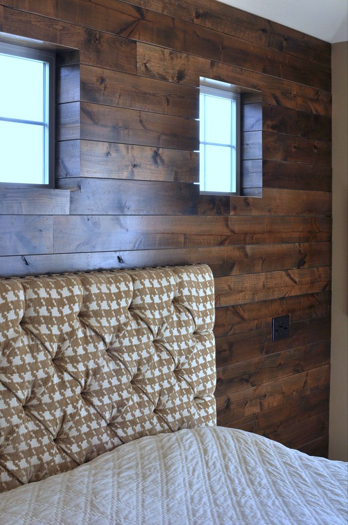 Love this stained wood wall with the fabric headboard in the tan houndstooth fabric. Sophisticated with lots of texture and depth.