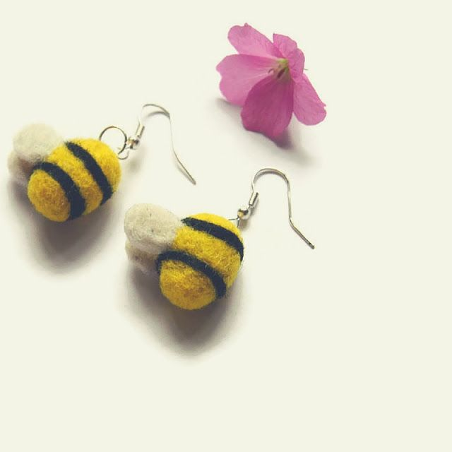 These precious and elegant Bumblebee Drop Earrings have been carefully handmade using the needle felting technique.   They are made from the highest quality and ethically sourced wool. Due to the pair being handmade they are ever so slightly different from each other, so if you are looking for an exact pair these may not be for you.  Each Bee is approximately 2 x 2 cm. They are securely attached to silver plated fish hooks for pierced ears.