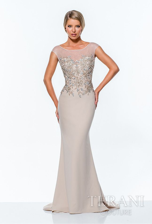 Terani 151E0275 form-fitting column gown featuring mesh chest/cap sleeves and bodice embellished with sequins arranged in a floral motif at the midsection