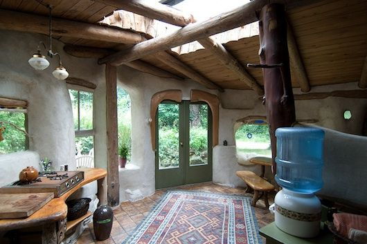 The trick to making cob attractive seems to be lots of light, a floor that isn't cob, and having wood mixed in. This site has lots of good pics.