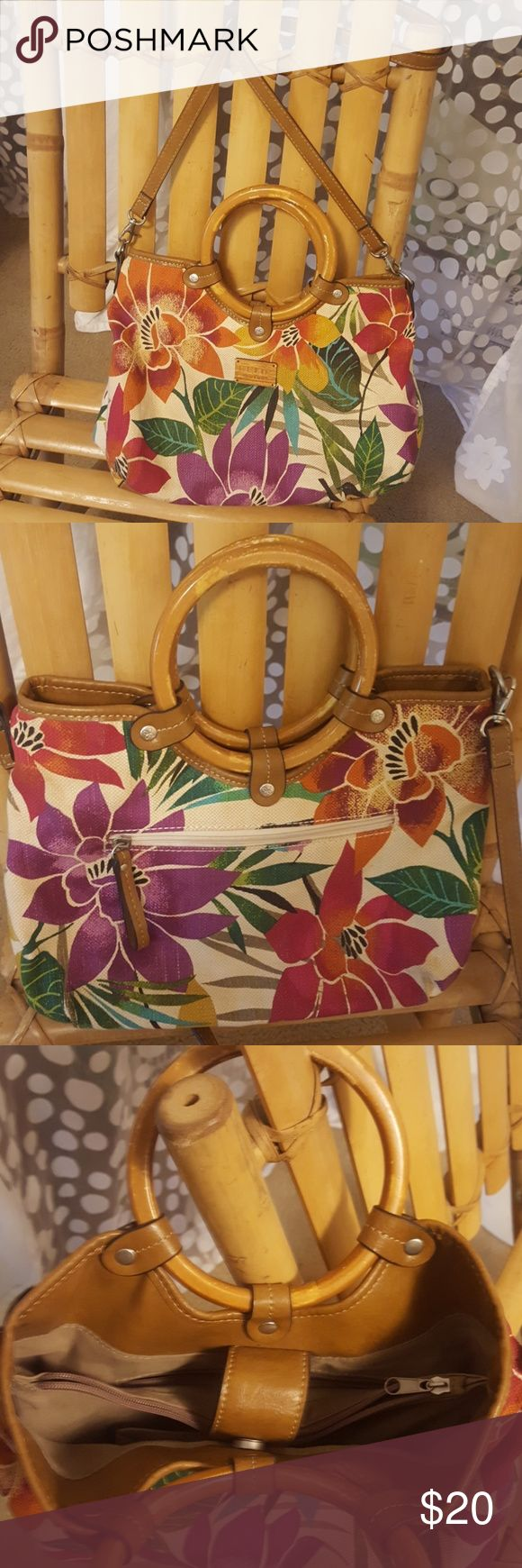 "Relic bag Floral print canvas, faux leather trim (on bottom as well), two interior zip pockets and one exterior zip pocket, interior easy slip-in cell pocket, unclip the shoulder strap and use as a handbag if you like. Approximate measurements: 40"" strap, 9""?12""?4"" body. Relic  Bags"