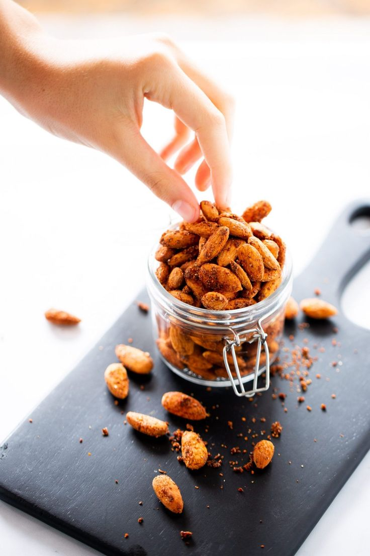 This recipe for spicy vegan roasted almonds is one of my favorite Mexican snack recipes. Eat them as an afternoon treat, put them on a veggie board with hummus and other crudités or mix with homemade popcorn. Enchiladas, Mexican Snacks, Homemade Popcorn, Vegan Roast, Roasted Almonds, Hummus, Spicy, Snack Recipes, Treats