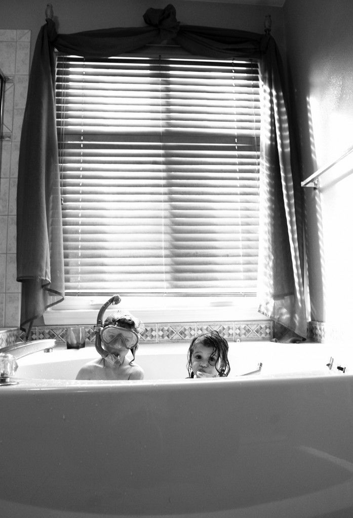 Lifestyle photography- photographing childhood.  Fun bath photos.  Kids in bath with snorkels, goggles and masks.  Creative family photography.  Gathering Light Photography