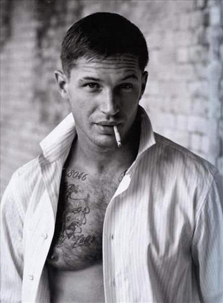 Tom Hardy---kind of has that Marlon Brando look with the cig hanging from those gorgeous lips and that mouth. He win. I can't...
