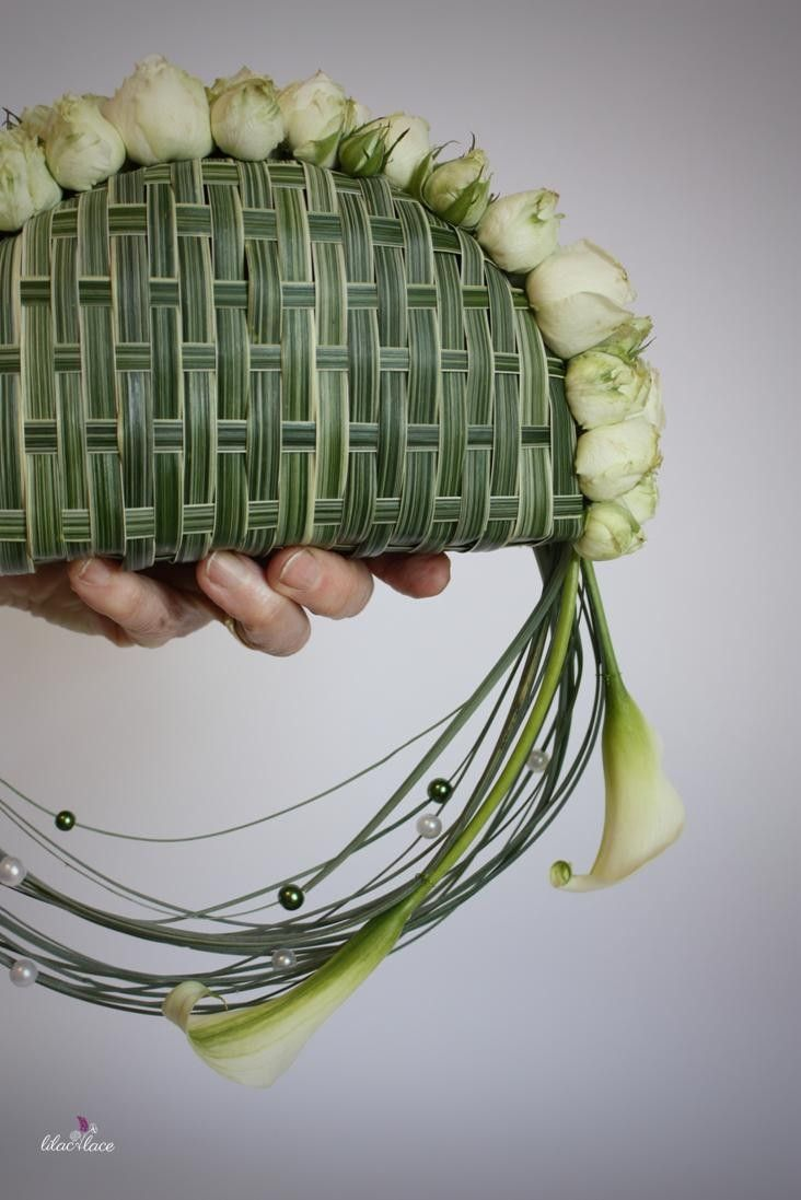 Looking for something different from the traditional bridal bouquet?  How about a floral clutch bag..  This one has woven China grass, Calla Lily and beads threaded on Bear grass
