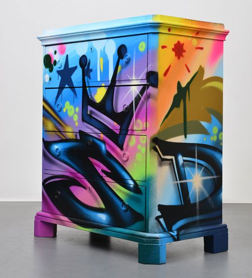 i really like the bright colors and graffiti art on this dresser... i think even if it was in a beige room it would make the room look neat... but maybe if its in a painted room it would be overkill. dunno :/