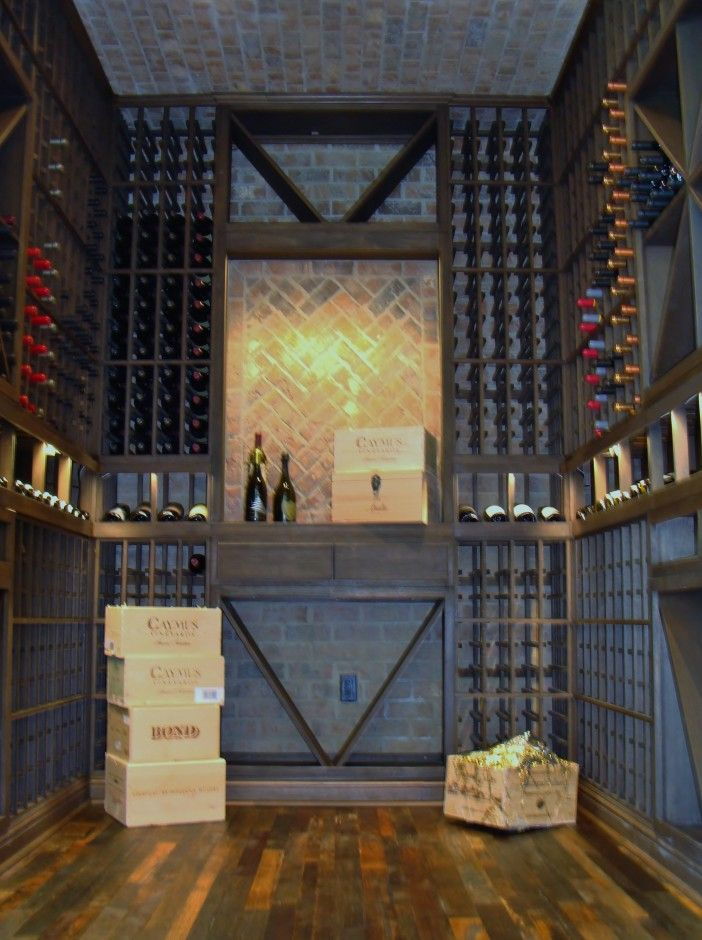Stunning residential wine cellar at Newport Beach California. Main features include the brick walls, horizontal display row, wine barrel flooring, LED lighting and the wine racking system. Click here to take a video tour of the project - http://www.winecellarsbycoastalblog.com/wine-cellar-builders-newport-beach-california-offshore-project/.