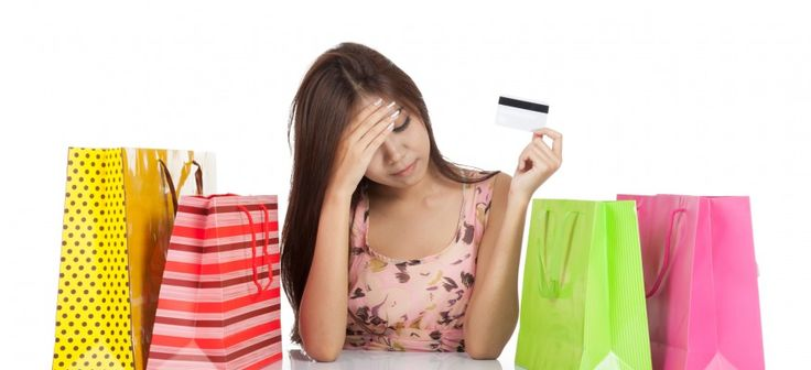 Woman fed up with credit card debt after a shopping trip