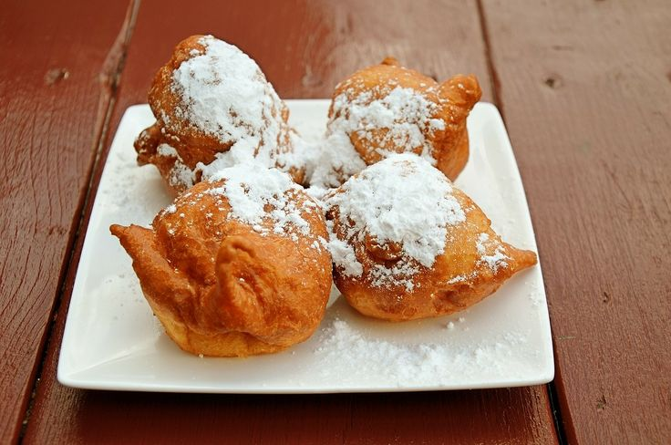 """Doughnuts have long been linked to Mardi Gras or """"Fat Tuesday."""" In Louisiana, fried dough pillows called beignets are the favorite. Make the dough the night before; then fry in the morning so they're hot andheavenly!"""