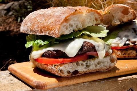 Double-decker marinated portobello burger (lacto-ovo vegetarian)