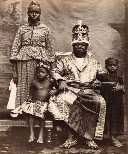 King Duke IX of Old Calabar, 1895. I wonder if that is the Queen Duchess standing next to him, or the washer woman?