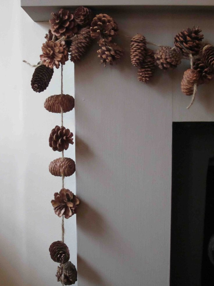 Pine Cone Garland from Jim Fairfax. This natural garland would be easy for little ones to make! Simply loop or tie twine around the middle of each pine cone and hang from the mantle!
