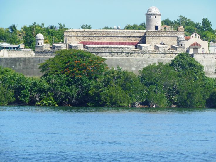We sailed past Castillo de Jagua, which overlooks the mouth of the Bahia de Jagua (also called Bay of Cienfuegos). The 22km-long passage terminates at the marina, malecon, and the city. The limestone fortress was built as a defense against pirates by King Philip V of Spain in 1742 and is now open to visitors. A Blue Lady is said to haunt the passage from the chapel to the high walls. However, I did not see her. (Photo by Kathryn MacDonald; http://www.travelnotebook.ca/home.html)