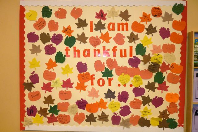have everyone fill out something they are thankful for, and put it on the board.. this could also be a program.