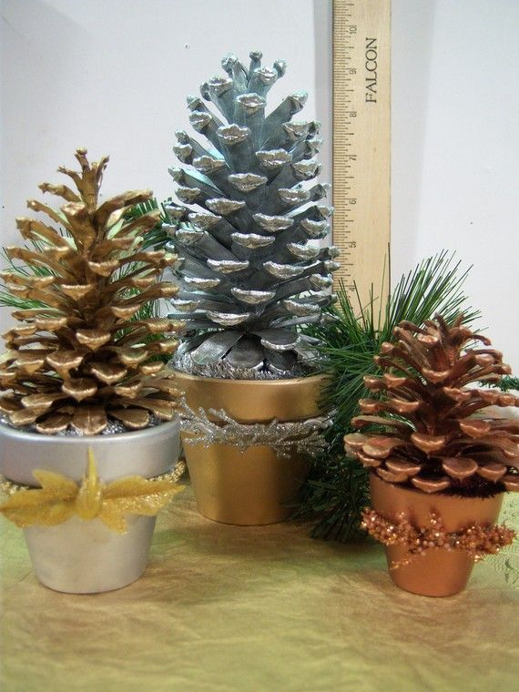 pinecones maybe I could use some plastic ones I have and paint them maybe add a touch of ribbon.