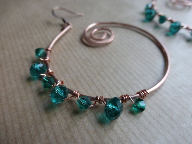 Earrings: Hammered Copper Spirals With Turquoise Glass Crystal Beads by TheCatAndTheClasp on Etsy