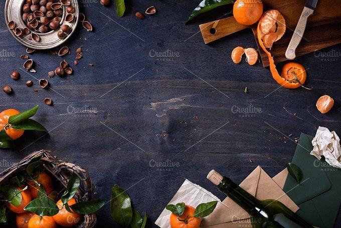 Mandarin fruits with hazelnuts, wine by Iuliia Leonova on @creativemarket