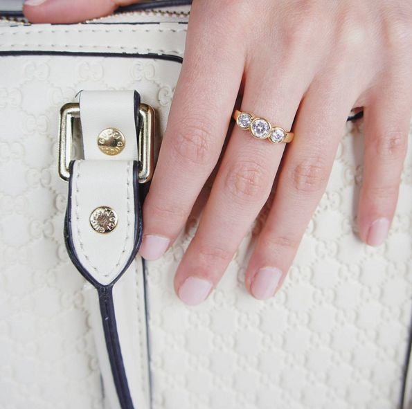 Anniversary Ring: Timeless design of this ring ensures its perfect compatibility with any other of Jewel's pieces and with any occasion. Anniversary style ring set with Signity Swarovski crystals. 18 carat gold electroplated over silver. $99.90