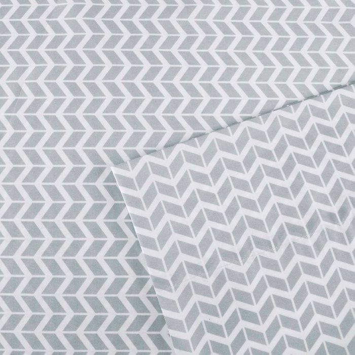 """The Intelligent Design Chevron Sheet Set adds a bright and colorful style to your bedroom. This super soft sheet set sports a chevron print in bold colors, for a fun and vibrant pop of color! The soft and smooth microfiber is naturally wrinkle-free, while offering exceptional comfort. The fitted sheet fits up to a 14"""" mattress."""