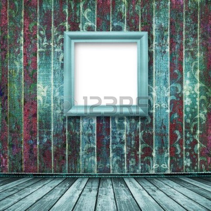 Oude turquoise frames Victoriaanse stijl op de muur in de kamer Stockfoto