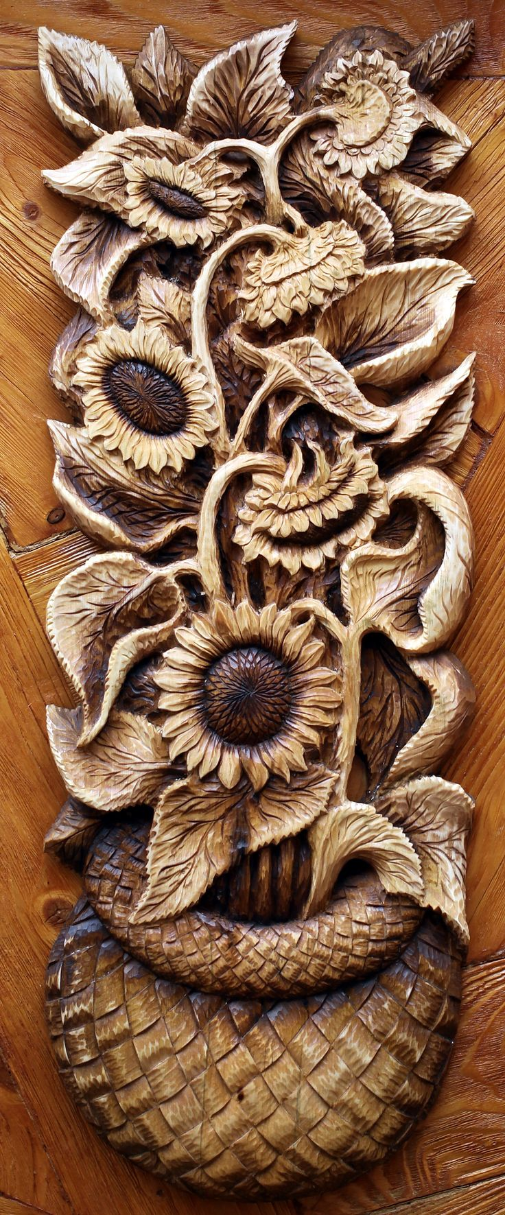 Carved Sunflowers in a basket.