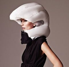 "Invisible bike helmet protects head and haute couture  By Jenny Wilson | August 25, 2012,   Invented by two Swedish women, the Hövding bike helmet keeps fashion-conscious cyclists safe without compromising their appearance. Designed to inflate over your head in the case of an accident, the ""helmet"" takes the form of a collar during regular use. Sitting around the neck, it's intended to blend in to clothing and prevent the oft-feared fashion faux-pas"