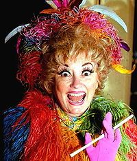 "Phyllis Diller (born Phyllis Ada Driver; July 17, 1917) is an American actress and comedian. She created a stage persona of a wild-haired, eccentrically dressed housewife who makes self-deprecating jokes about her age and appearance, her terrible cooking, and a husband named ""Fang"", while pretending to smoke from a long cigarette holder. Diller's signature is her unusual laugh."