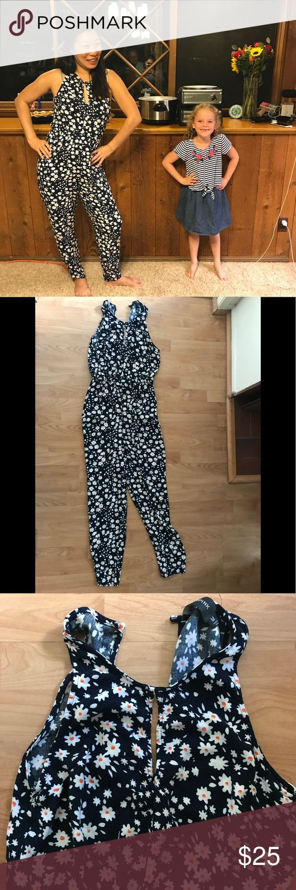 """MINKPINK Romper Jumpsuit Floral and so cute! This is in great shape and I love it to death. But want someone to have it. I'm 5'7"""" 31"""" waist. 34c bust.  This has room to wiggle if I were to gain weight.  Some thread runs in the fabric as pictured but only noticeable from close up. MINKPINK Pants Jumpsuits & Rompers"""