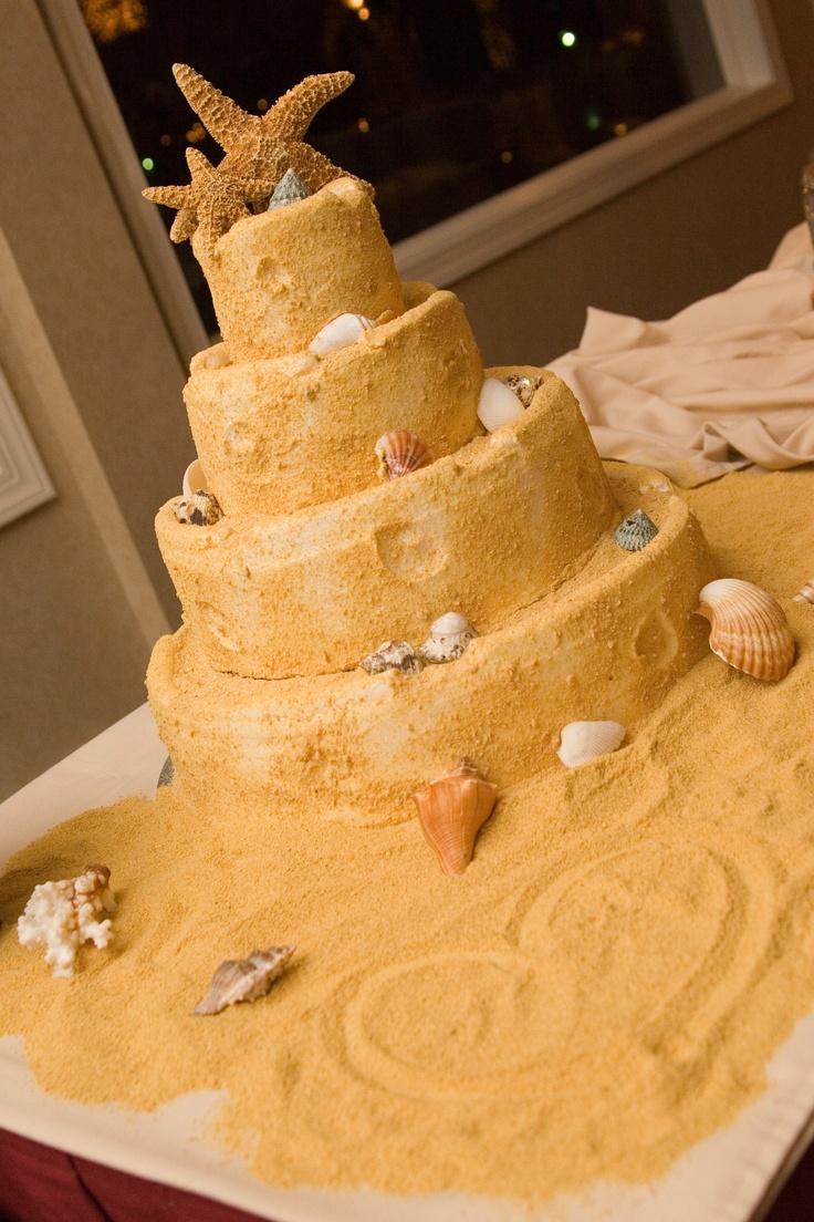 Sand castle themed wedding cake