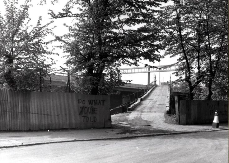 Westway flyover construction. (Late 1960s).This is temporary ramp up onto motorway for construction vehicles from Cambridge Gardens. This is now Portobello Green, by the canopy of Westway Market. https://rbkclocalstudies.wordpress.com/2012/02/23/the-writing-on-the-wall-old-school-graffiti-in-kensington-and-chelsea/ By Dave Walker These 2 pictures are from Roger Perry and George Melly's 1976 book on London graffiti