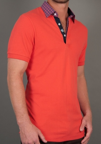 A poppy red, polo shirt, fitted body with a dress shirt woven button down collar.