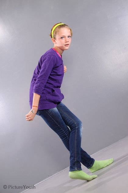 Trendy preteen girl shows off some cool dance moves.  #child #dancing #custom photography  PictureYouth.com