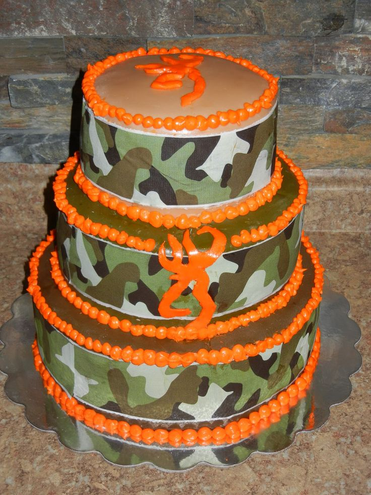 OK...not the ORANGE balls so much, we want orange flowers, MUST HAVE THE BROWNING dear thingy, and the camo ribbon can be smaller to show the brown....