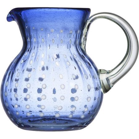Add a bold pop of color to your tablescape with this upcycled glass pitcher, perfect for serving sweet sangria or crisp lemonade.Prod...