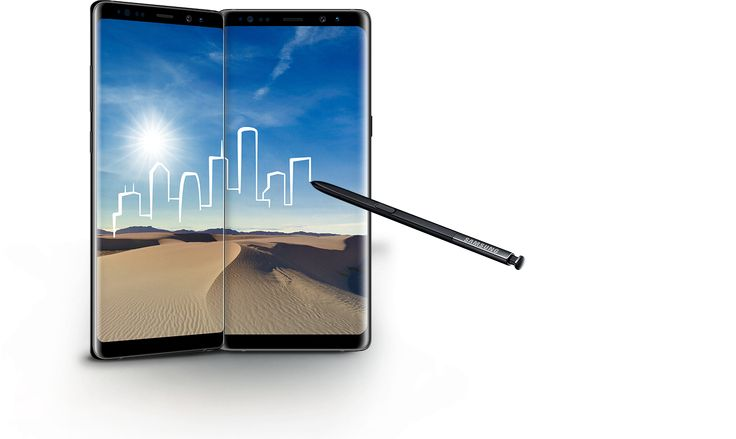 An S Pen is drawing the outline of a city skyline over a landscape photo of a desert, spread across the screens of two Galaxy Note8s.